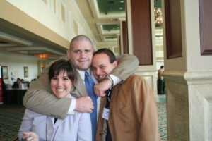 Rulon headlocks Brett and Sonia